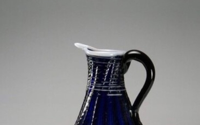 Blue ribbed glass jug decorated with white threads.