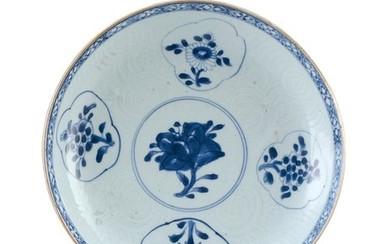 """CHINESE BLUE AND WHITE PORCELAIN PLATE With floral cartouches on a carved cloud ground. Diameter 8.5""""."""