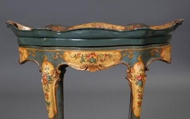 Carved and painted wooden tray table with flower decoration, possibly Italy, c.1900. With glass top. Size: 63x47x69 cm. Output: 225uros. (37.437 Ptas.)