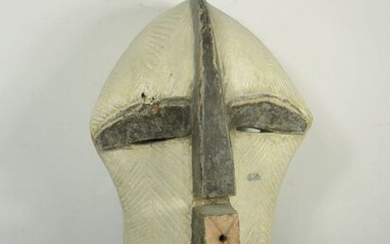 "Cubist"" style MASK Heavy wood. Small lacks and splinters, cracks and a worn out hole. Mouth, ears and crest extending with the nose. Zaire, Songye. In the family for 50 years. Height 47 cm"