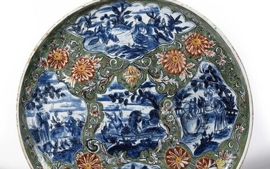 Delft (kind of) Round Chinese dcb earthenware dish in landscapes on a green flowery background. Beginning of the 20th century. D. 41,5 cm.