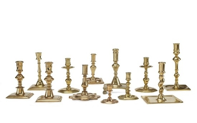 Group of twelve Continental brass candlesticks Dutch, Flemish, and...