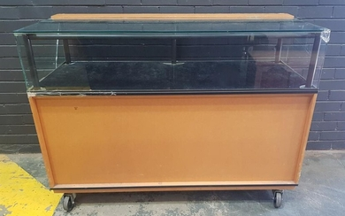 Large Timber and Glass Display Case on Castors - large crack to glass and scratching to top (H:110 x W:150 x D:62cm)