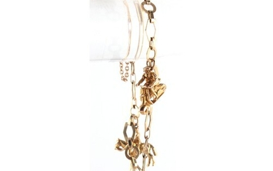Property of a lady - a 9ct gold charm bracelet with three ch...