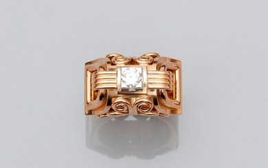 Ring in yellow gold 750MM and platinum 900 MM, decorated with scrolls, bars and loops crowned with a round diamond, width 14 mm, height 11 mm, circa 1940, size : 52, weight : 7,7gr. rough.
