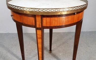 TABLE BOUILLOTTE in the Louis XVI style inlaid and topped...