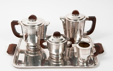 Tea-coffee serving set (4 pieces) in silver plated metal decorated with fillets under the neck and on the pedestal, comprising a teapot, a coffee pot, a milk jug, a covered sugar bowl and a rectangular tray.