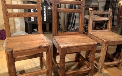 Three chairs with two crossbars and fluted upright...