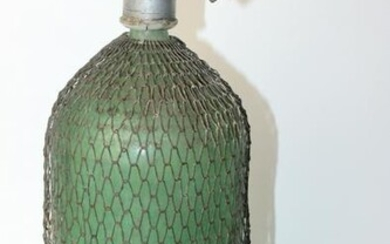 Vintage seltzer bottle covered with wire mesh
