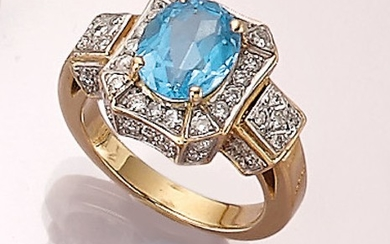18 kt gold ring with blue topaz...