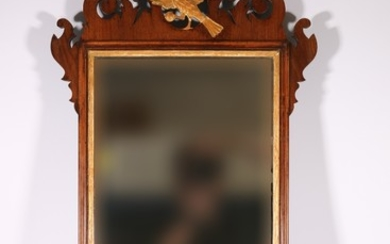 19th century mahogany fret carved wall mirror with gilded ea...