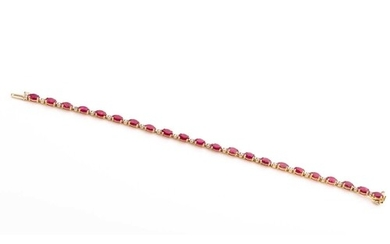 A 14ct yellow gold, diamond, and ruby bracelet, set with twe...