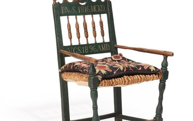A 19th century painted wood armchair carved with foliage, painted with owner's initials and year 1816, woven seat.