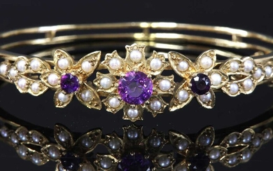 A 9ct gold amethyst and split cultured pearl hinged bangle, c.1970