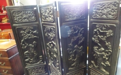 A Chinese carved hardwood four fold screen decorated with Ga...