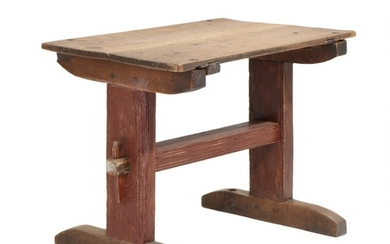 A Danish early 19th century table with solid oak top, redpainted base. H. 74. L. 98. W. 63 cm.