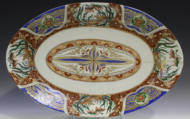 A Japanese Imari porcelain oval dish, Meiji period, painted and gilt with a central foliate medallio