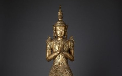 A LARGE BURMESE CARVED AND GILT LACQUERED WOOD...