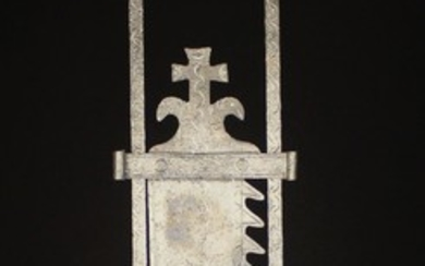 A Large 16th century Style Wrought Iron Chimney Crane with height adjustable ratchet, incised and pu