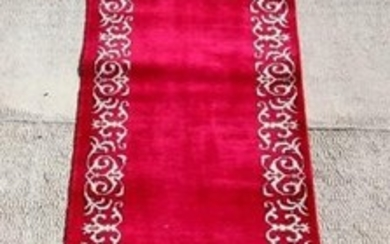 A Persian Tabriz woollen hand knotted runner with stylised b...
