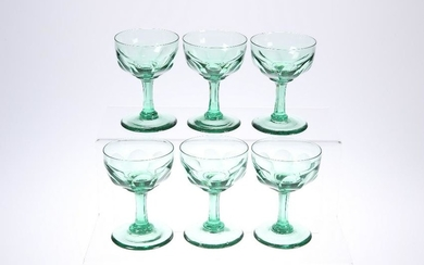 A SET OF SIX LATE VICTORIAN GREEN-GLASS CHAMPAGNE