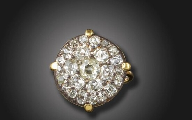 A diamond cluster ring, the George III circular section (possibly converted from a button) set with old circular-cut diamonds in silver, claw-set in a later gold ring, size J