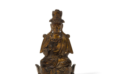 A gilt copper alloy seated Buddhist figure