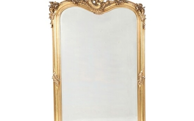 A large French Rococo style portal shape giltwood and gesso mirror with facet cut glass....