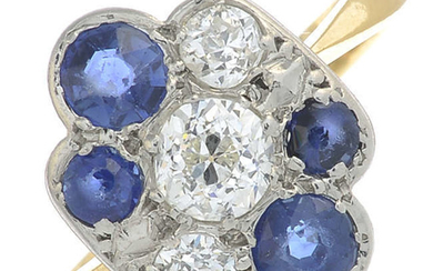 A mid 20th century gold and platinum circular-shape sapphire and old-cut diamond ring.