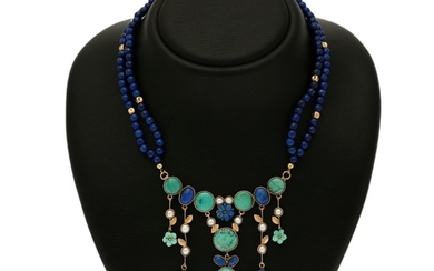 A necklace set with numerous lapis lazuli, turquoise, cultured fresh water pearls and a pear shaped blue stone, mounted in 14k gold. L. app. 43.5 cm.
