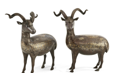 A pair of Qajar gold and silver damascened steel rams, Persia, 19th Century
