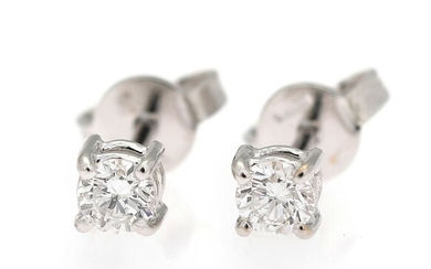 SOLD. A pair of diamond ear studs each set with a brilliant-cut diamond weighing a...
