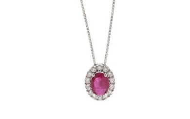 A pendant set with an oval-cut ruby weighing app. 0.64 ct. encircled by numerous diamonds, mounted in 18k white gold. Accompanied by chain of 18k white gold.