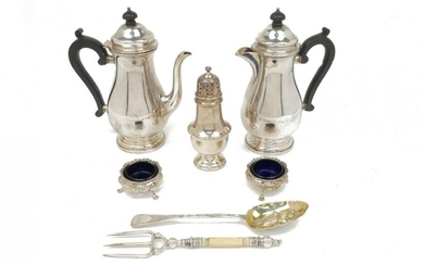 A silver coffee pot and a silver...