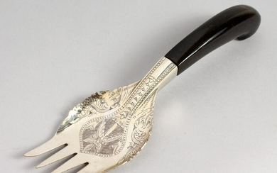 AN EASTERN WHITE METAL FORK, with engraved decoration.