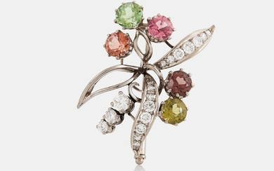 An 18K white gold brooch set with round- and eight-cut diamonds and coloured stones