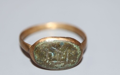 An antique gilt metal and oval bronze plaque set ring, size ...
