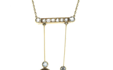 An early 20th century Russian gold, colourless paste and synthetic ruby negligee necklace.