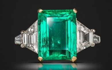 An emerald and diamond ring, the emerald-cut emerald weighs 5.03cts, set with a trapeze-shaped and tapered baguette-shaped diamond to each shoulder in platinum and gold, French platinum hallmark, size M 1/2 Accompanied by report number 18050150 dated...