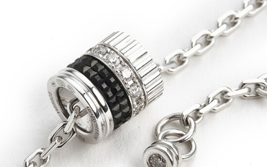 """Boucheron: A diamond bracelet """"Quatre"""" set with numerous brilliant-cut diamonds weighing a total of app. 0.21 ct., mounted in 18k white gold. D-G/IF-VS."""