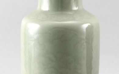 """CHINESE CELADON PORCELAIN VASE In baluster form, with lightly incised peony decoration. Height 11.25"""". With wood stand. Provenance:..."""
