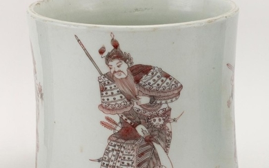 CHINESE RED AND WHITE PORCELAIN BRUSH POT With four warriors holding weaponry about the exterior. Six-character Kangxi mark on base....