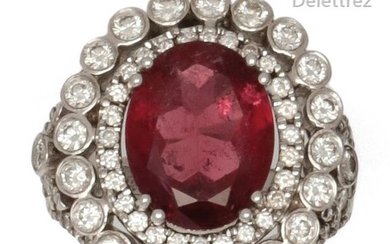 """Important ring """" Fleur """" in white gold, adorned with a tourmaline in a setting of brilliant-cut diamonds. The openwork ring with a foliage motif partially set. Turn of doigt : 52. P. Brut : 14 g."""