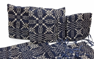 Seven Blue and White Woven Coverlet Seat Cushions and Pillows, Pennsylvania, c. 1830-40.