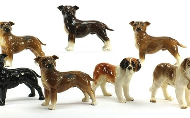 Seven Coopercraft hand painted porcelain dogs, each