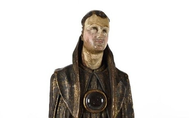 Spain 18th century Probably a Saint Franciscan Bust reliquary in polychrome wood with estofado decorations. Height 38 cm. Resting on a polychrome wooden base bearing an inscription (H. 10 cm.)