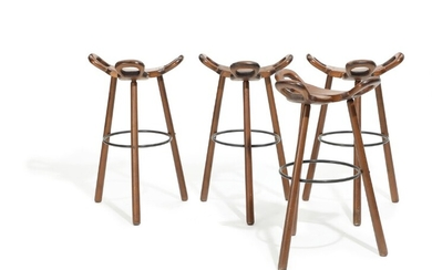 """Spanish design: """"Marbella"""". Set of four patinated solid beech bar chairs, three-legged frame and saddle shaped seat. H. 75 cm. (4)"""
