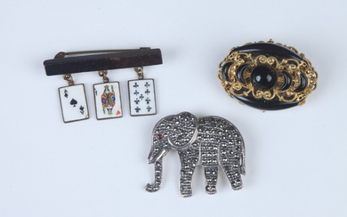 THREE ITEMS VINTAGE COSTUME JEWELRY. Including gilt scrolling openwork and...