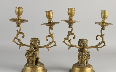 Two antique Dutch bronze candlesticks with Amsterdam