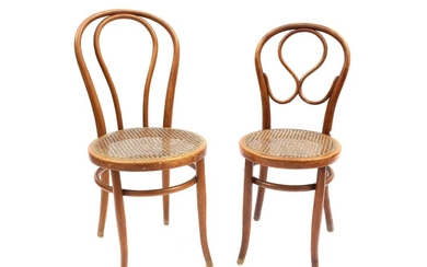 Two curved beech chairs